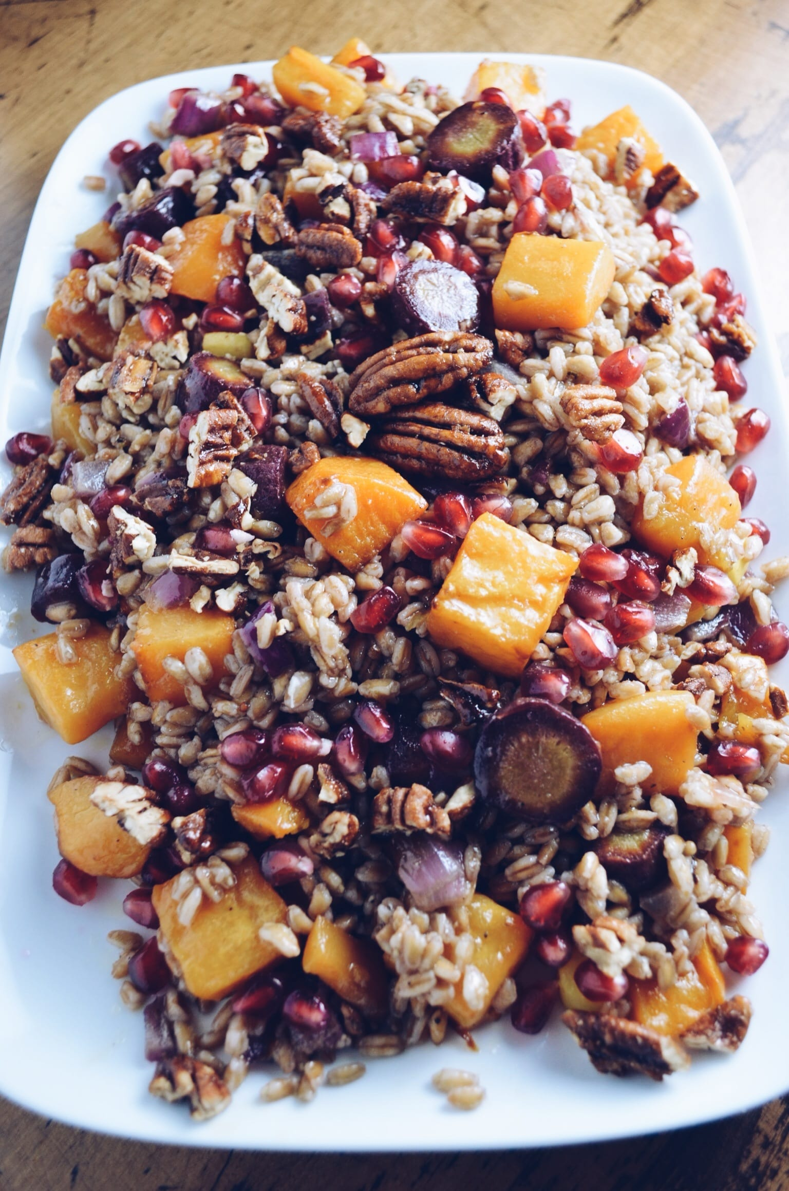 Farro Salad With Pomegranate Vinaigrette, Roasted Winter Vegetables, and Candied Pecans