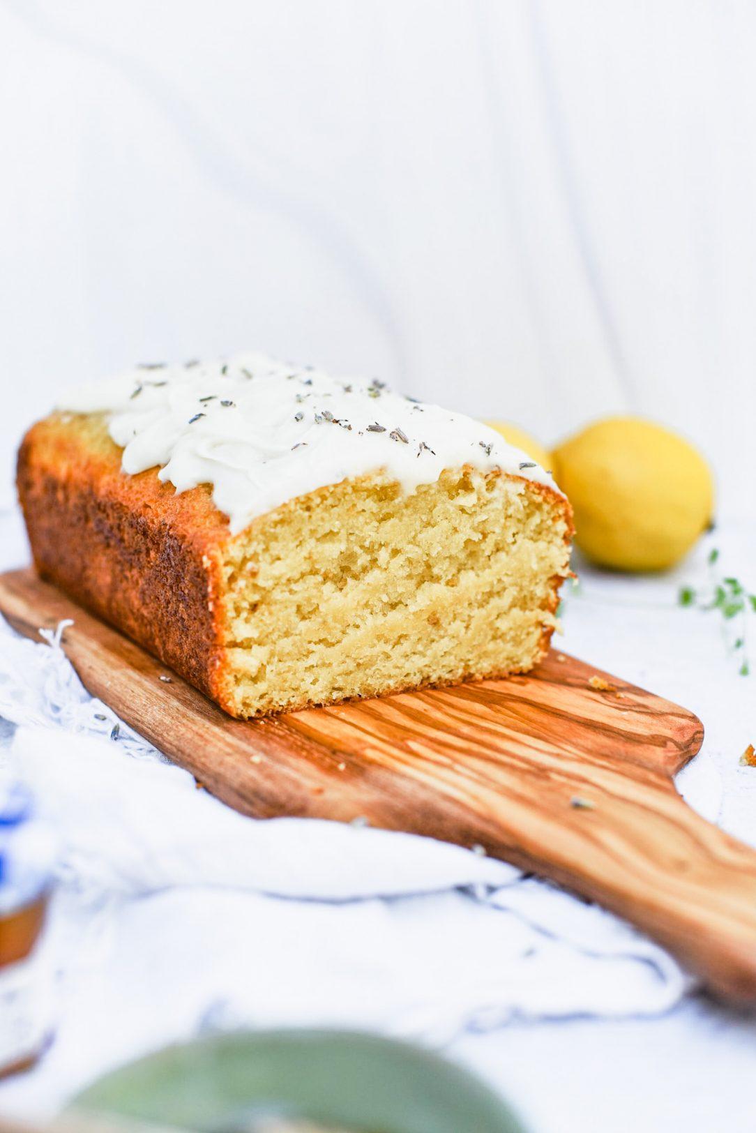 Sliced Lavender Honey Soaked Lemon Cake on a serving platter