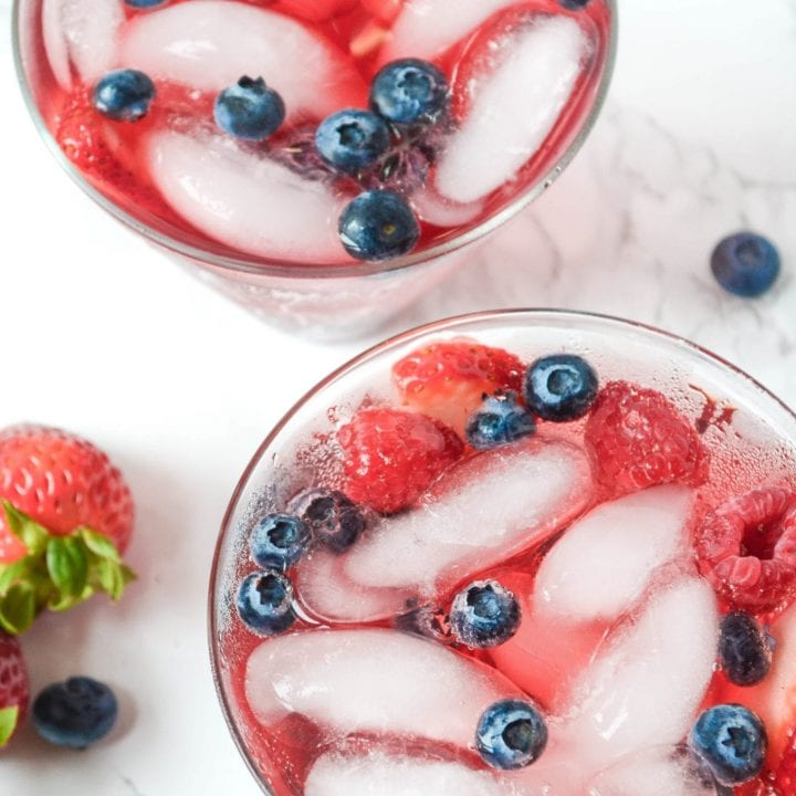 How is it almost The Fourth of July? Seriously, time is flying. So I'm going to take a second to enjoy my Sparkling Hibiscus Berry Cocktail