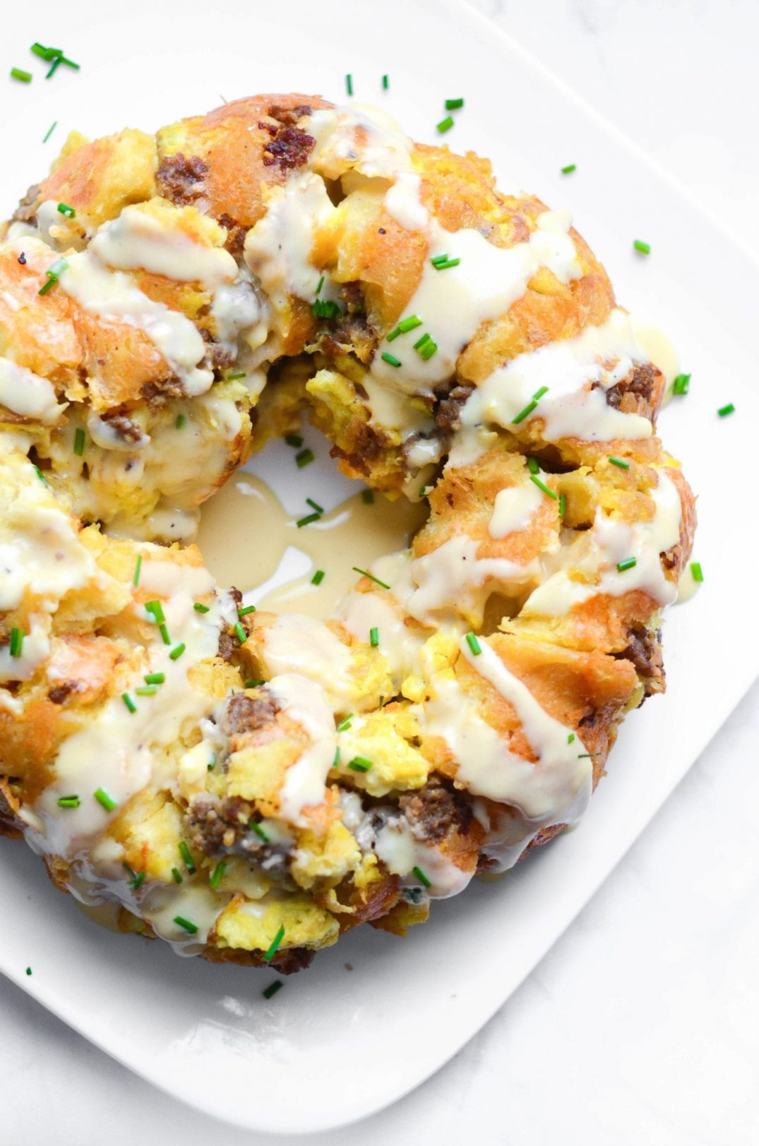 Cheesy Breakfast Monkey Bread With Sausage and Eggs