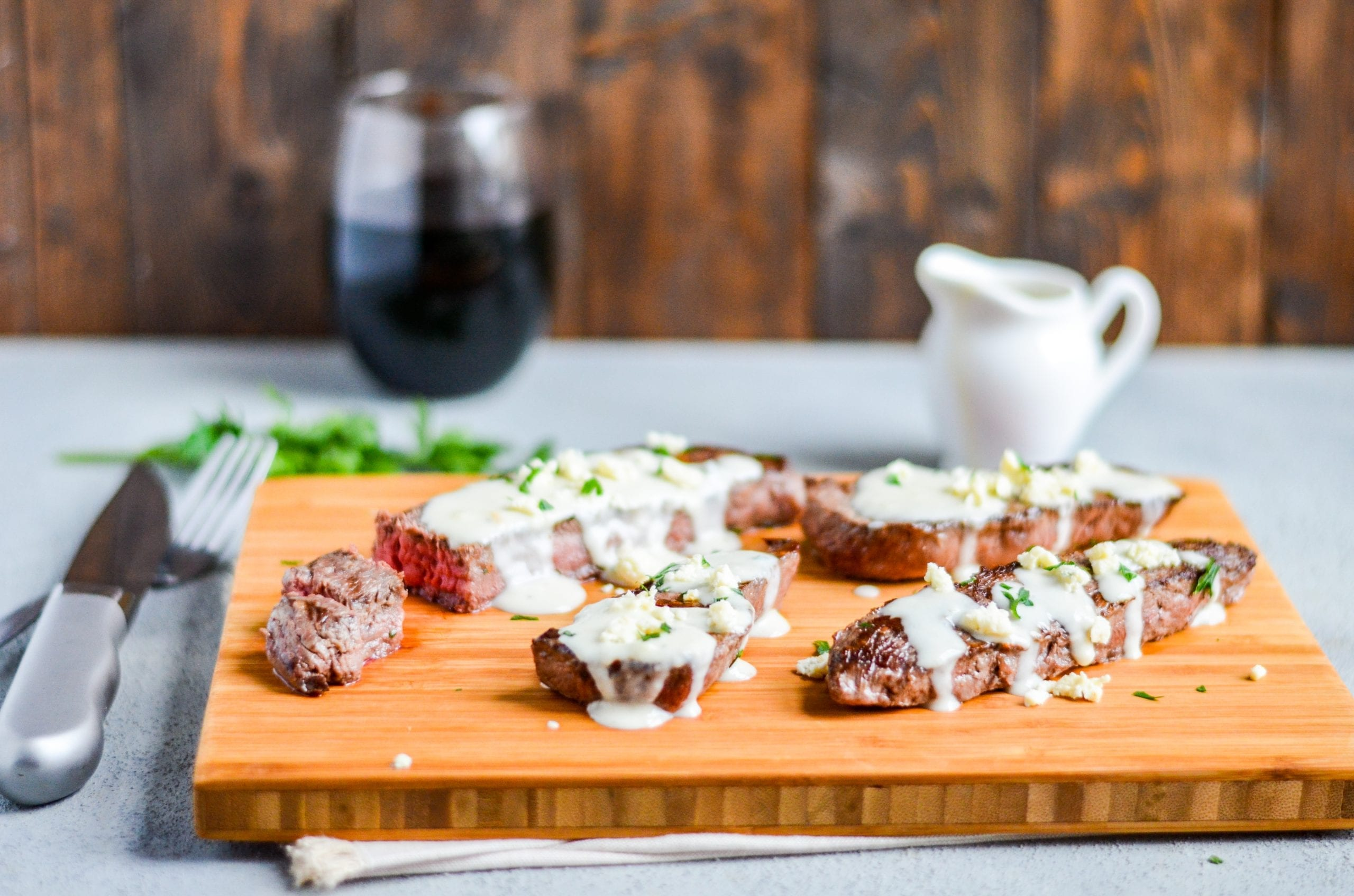 Grilled Sirloin Steaks with Roasted Garlic Gorgonzola Cream Sauce