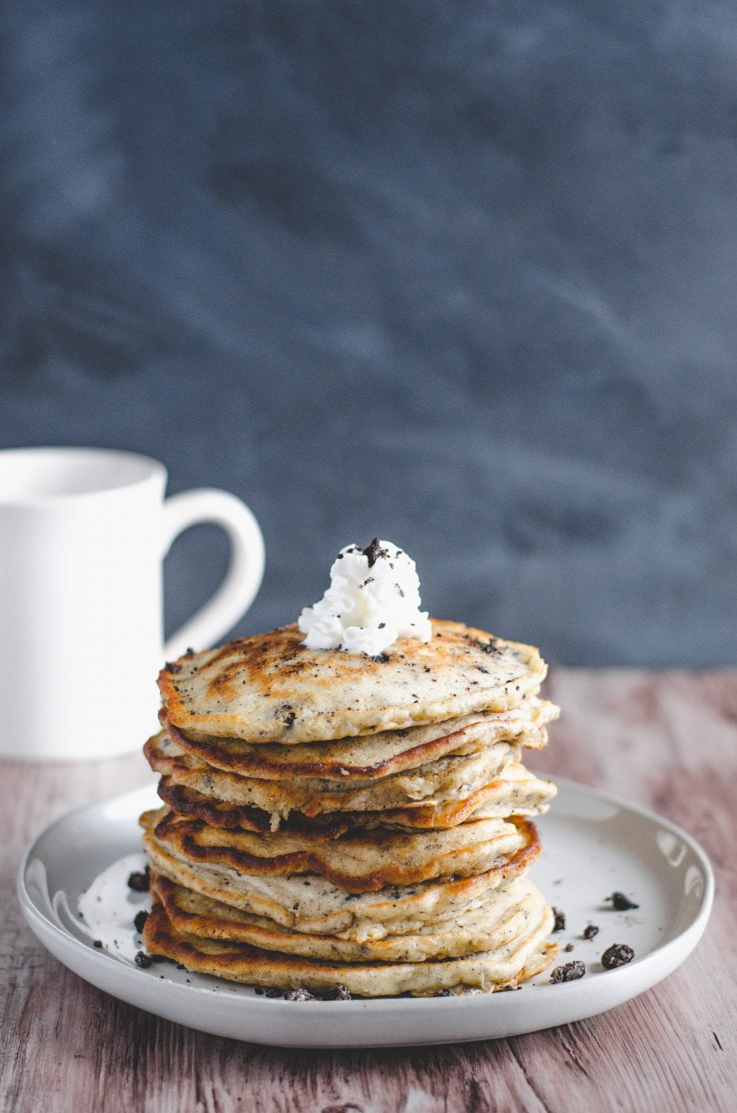 cookies and cream pancakes stacked on plate