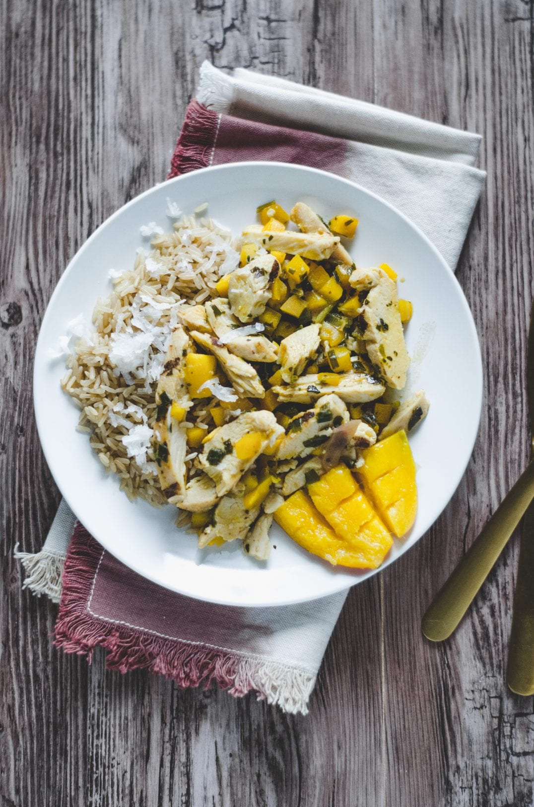 mango chicken with coconut rice on a plate