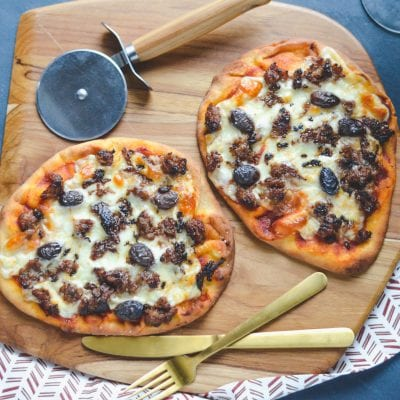 Personal Sausage and Olive Pizzas with Carnivor Cabernet Sauvignon