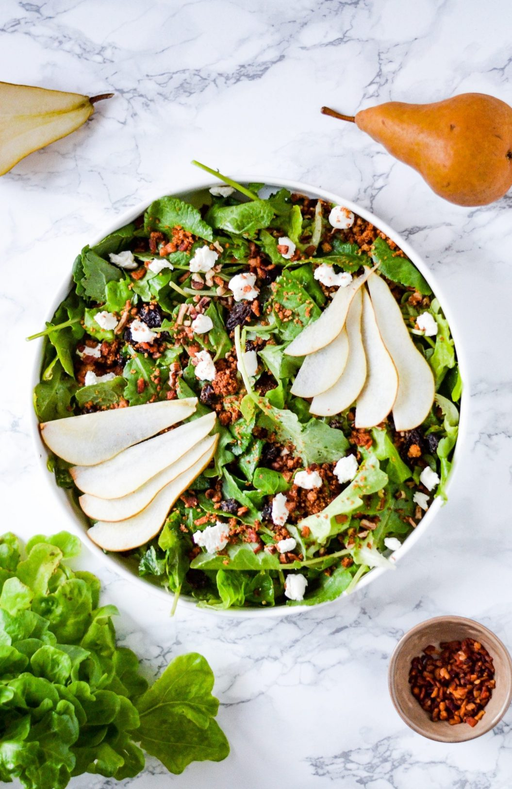 salad in bowl with sliced pears