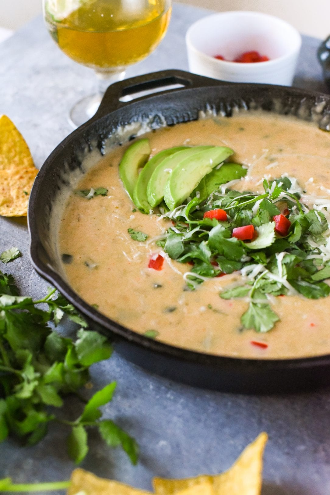 beer cheese queso in a cast-iron skillet