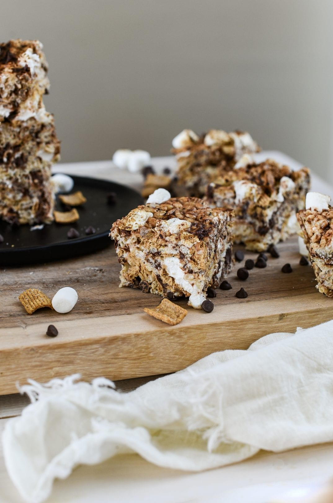 a sliced Toasted Marshmallow S'mores Rice Krispie Treats on a cutting board