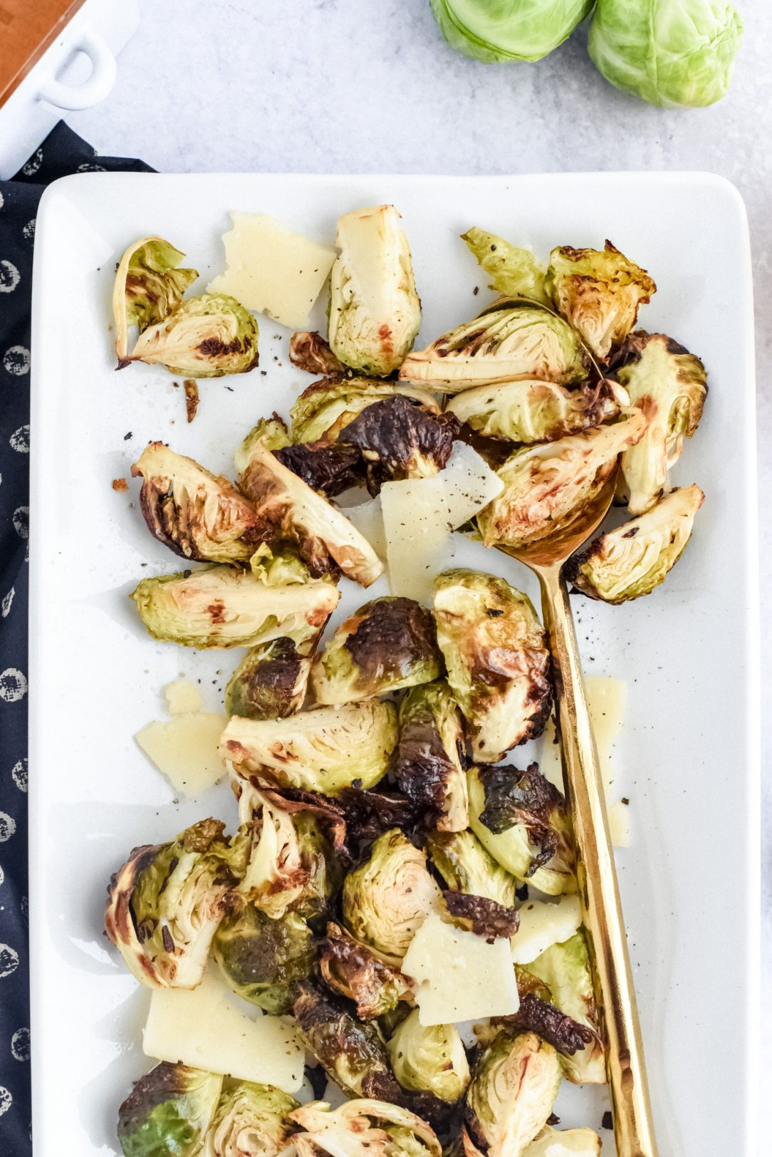 brussels sprouts spread out on plate with cheese