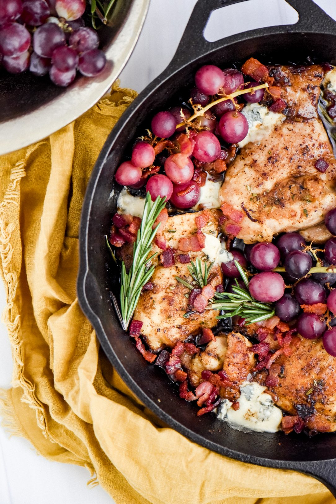 cooked chicken thighs in skillet