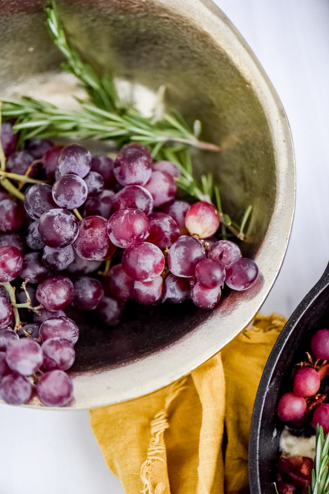 gold bowl filled with grapes