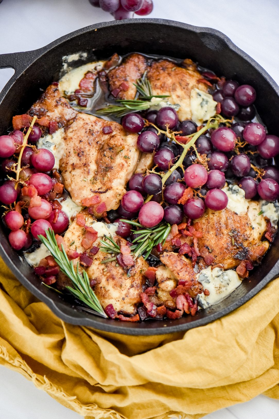 chicken, grapes, and cheese in skillet