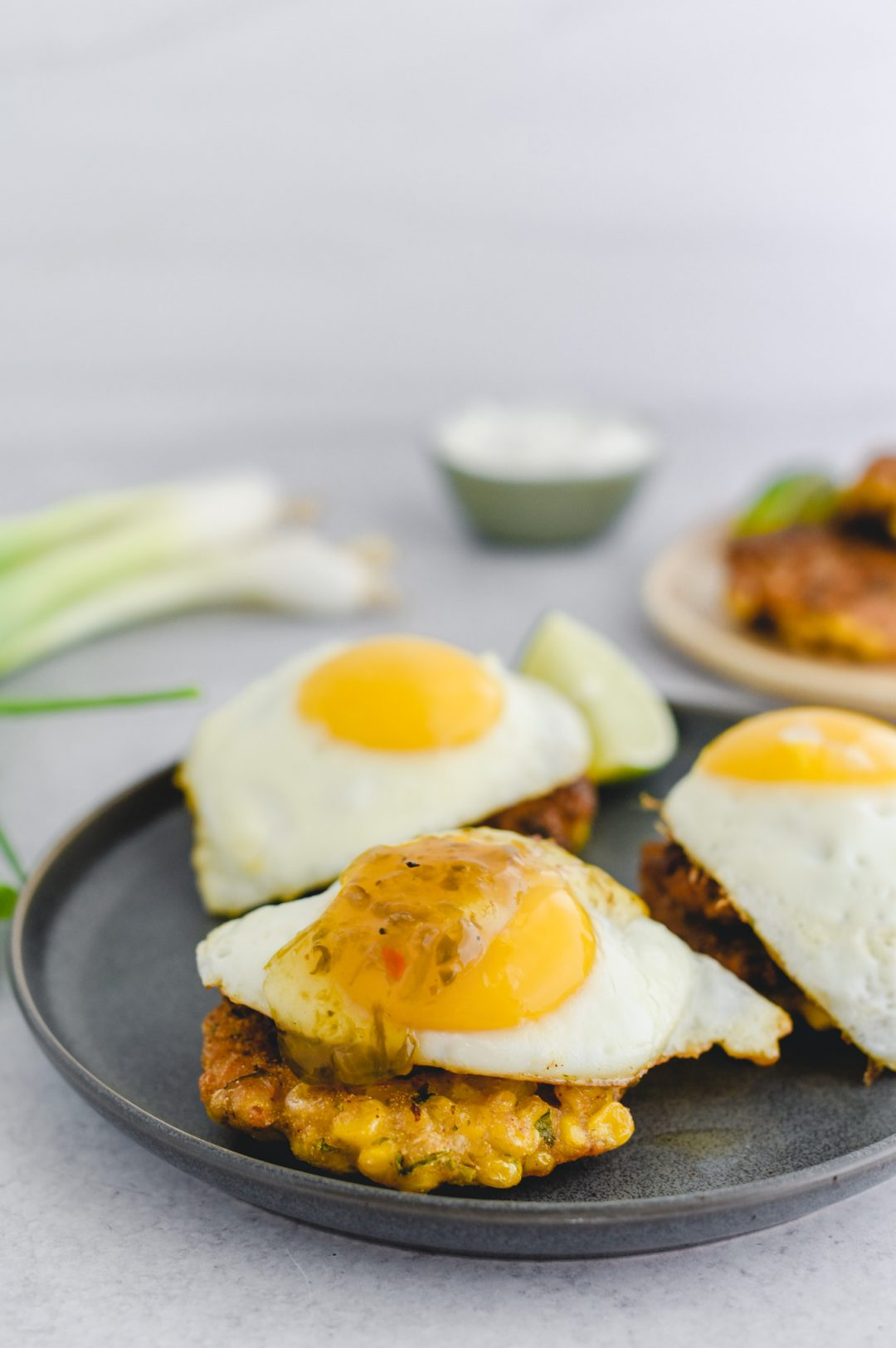 corn fritter with egg placed on top with jam