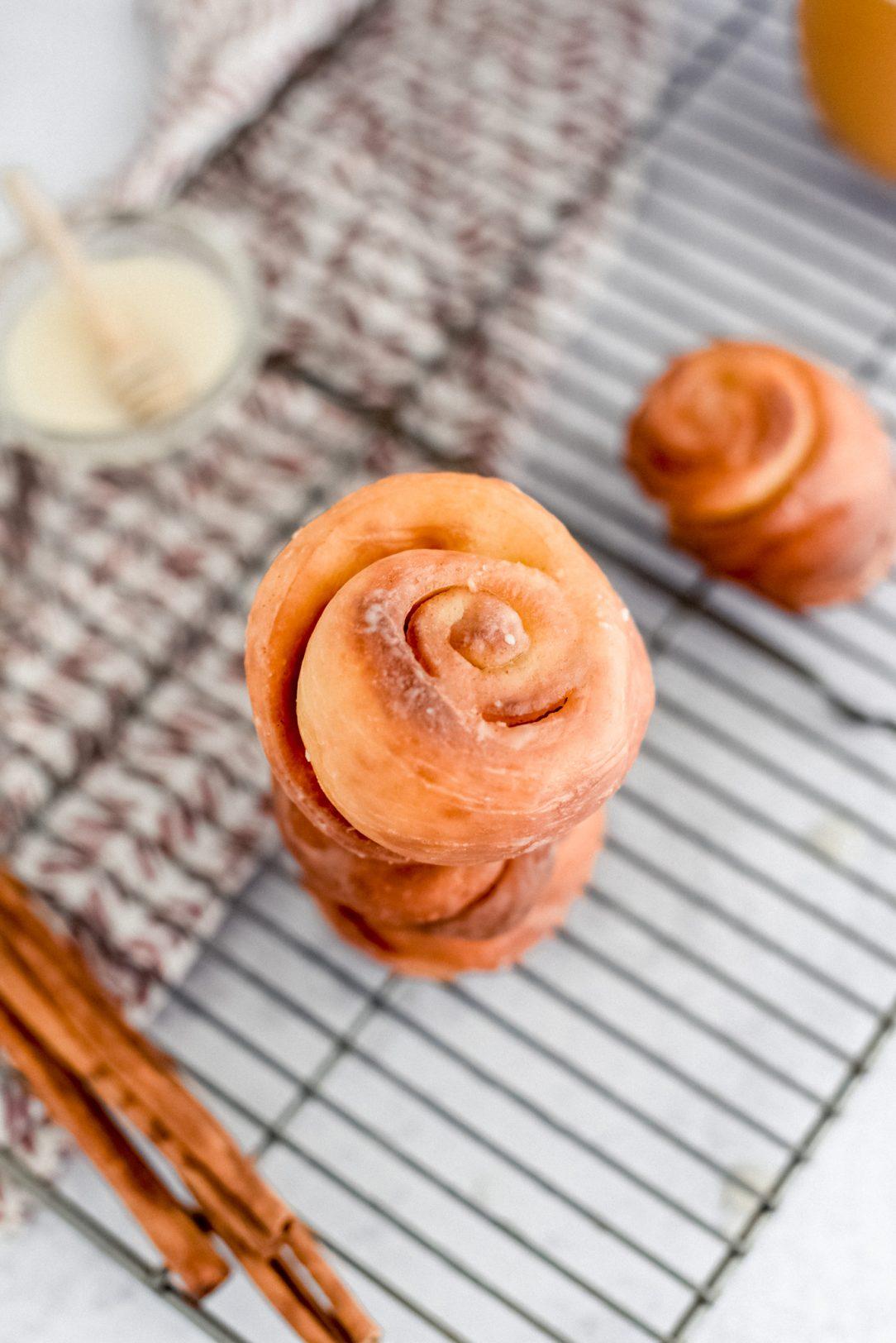 honey bun stacked on baking rack