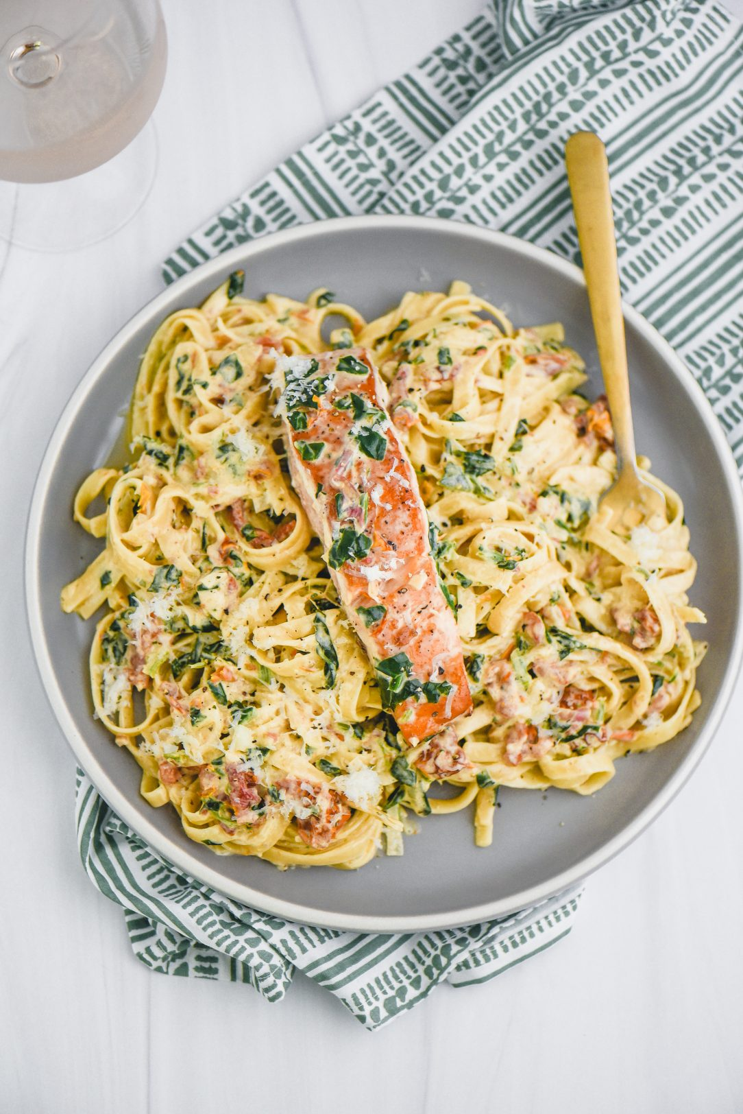 Tuscan Salmon Fettuccine Alfredo on a plate