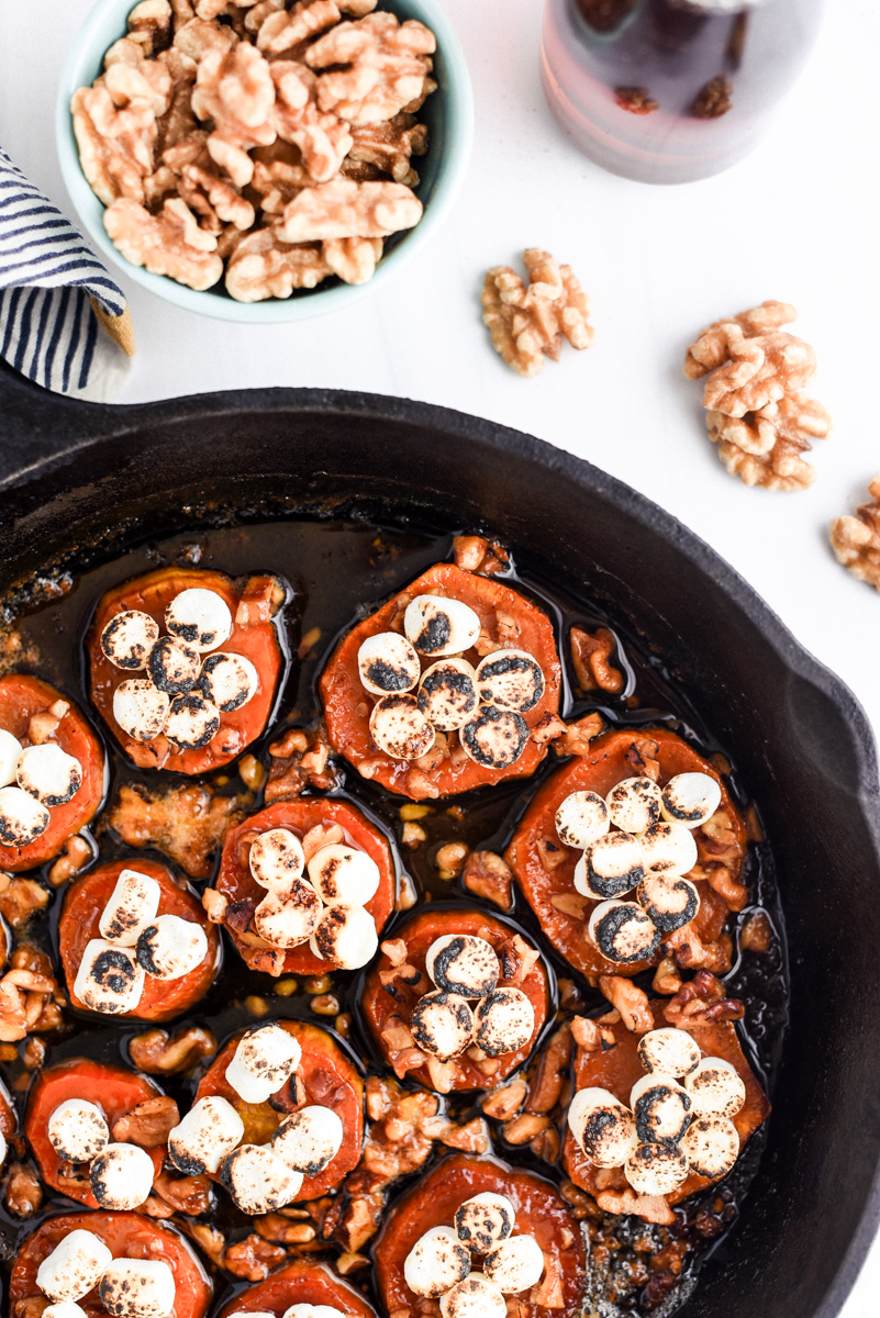 melting sweet potatoes with marshmallows and walnuts