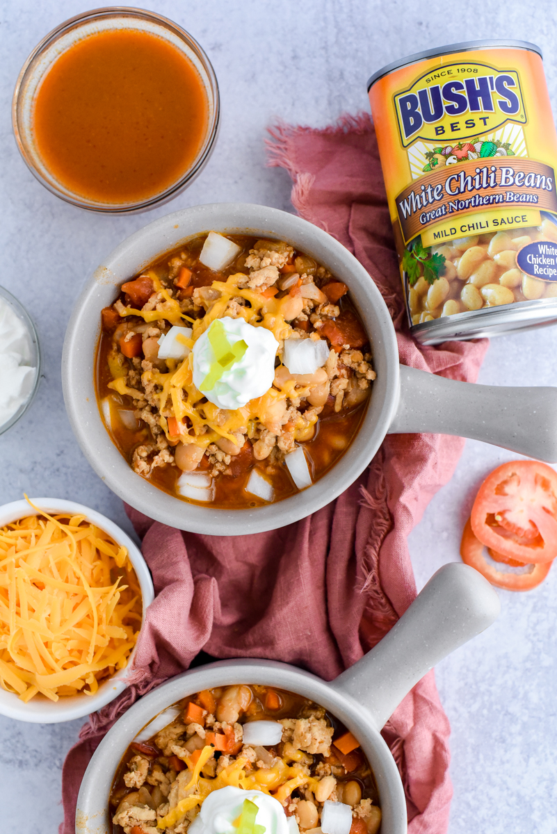 overhead shot of hot chicken chili in bowls