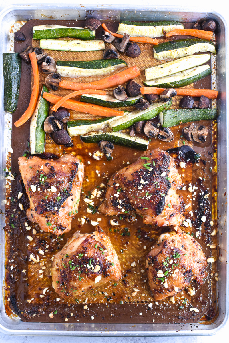 easy sheet pan peanut chicken on a plate with vegetables